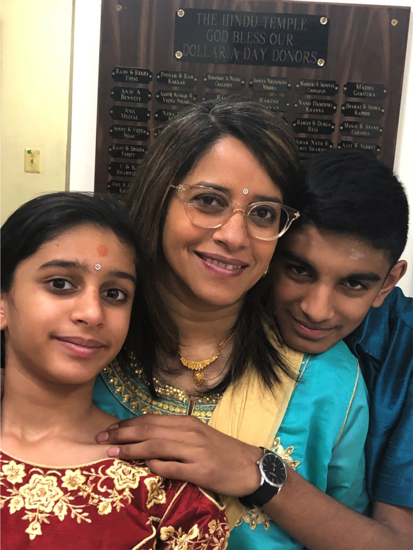 Githa with her children at a wedding